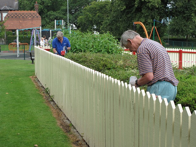 Painting the Infants Play Area fence