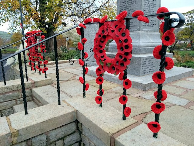 Knitted Poppies on the War Memorial