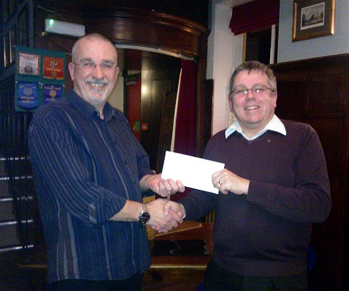 Rotary Cheque being received.